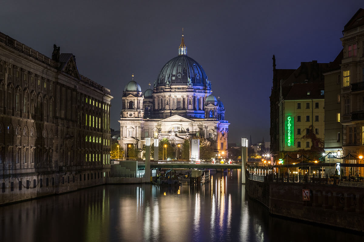 The Berlin Cathedral, in the trendy neighborhood of Mitte, lit up in a colorful light display.